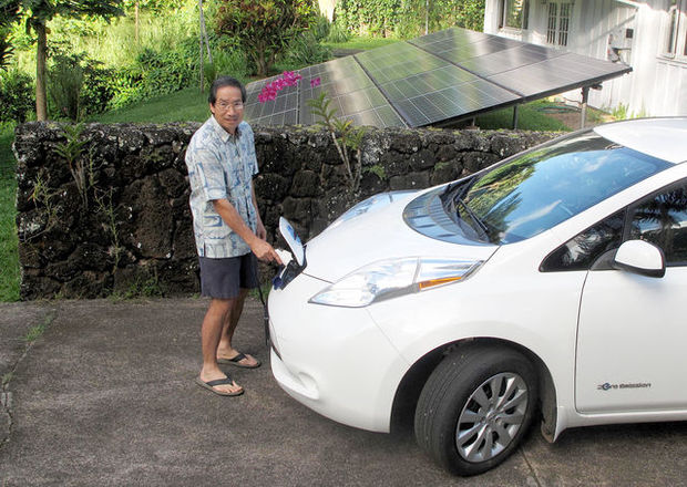 David Lee powers up his Nissan Leaf, which he bought to use up the excess energy generated by his PV system at his home in Koloa.
